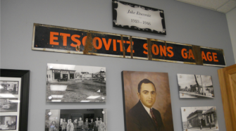 Shrine: The author in front of a wall dedicated to Jake Etscovitz at Valley Motors in Fort Kent, Jake's old garage.