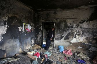 Terrorist Victims: A relative stands inside the burnt-out home of Saad Dawabsha, who was killed alongside his infant and wife when Jewish extremists firebombed their house in the West Bank village of Duma last July.