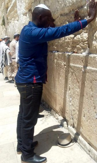 Pilgrim: Chideka Emmanuel prays at Jerusalem's Western Wall during a trip to Israel in May.