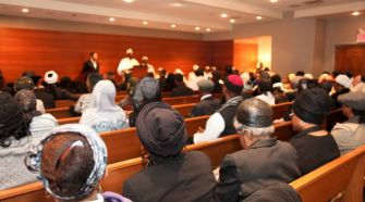 Mourners gather at Rabbi Hailu Moshe Paris' funeral.