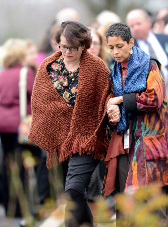Veronique Pozner, (left) Noah's mom, at his funeral in 2012.