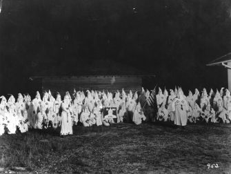 White Terror: Hooded Ku Klux Klan members meet, circa 1920. One leader of the white supremacist group praised Jews for being 'Klannish since the days of Abraham,' even as Jews were denounced as 'an evil influence.'