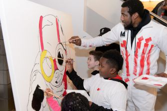 "Amar'e Stoudemire paints with children in Chicago last year as part of his ""In The Paint"" series, which combines sports and art activities."