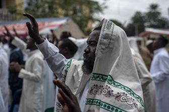 Members of the IPOB and of the Yahweh Yahshua Synagogue celebrate Shabbat outside the house of the movement's leader Nnamdi Kanu on May 27, 2017.