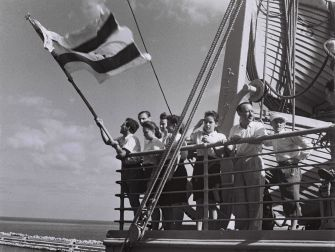 Long May They Wave: Jewish immigrants fly what would become the Israeli flag as they arrive in 1945 in Haifa.