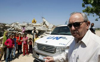 Driven: Richard Goldstone, arriving to inspect a destroyed home in Gaza City, says he hopes his controversial report will assist the peace process. Click to view larger.