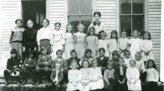 Class Photo: Jake's elementary school class in Fort Kent in the early 1900s. Jake is in the middle row, his hands on the shoulders of the boy in front of him.