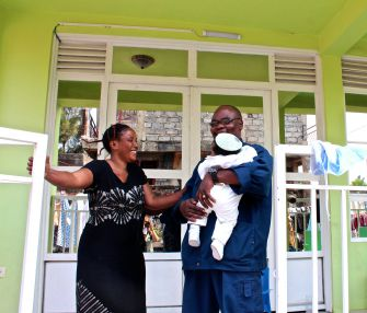 Aspiring Jew: Fidel Bafilemba poses with his wife, Ezeki Bafilemba, and their youngest child in front of his home in one of Goma's better-off communities.