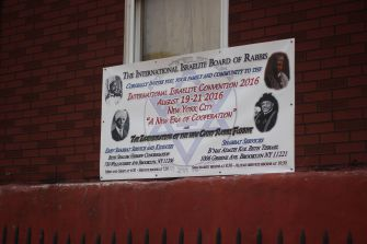 Legacy: An advertisement for the convention and inauguration pictures Hebrew Israelite patriarchs alongside Rabbi Funnye.