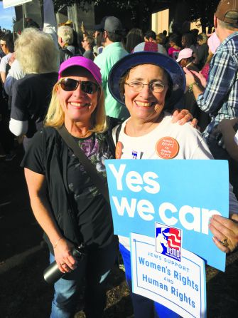 Southern, Jewish and Liberal: Julie Levinson-Gabis (left) and Linda Verin protest with about 5,000 others in Birmingham on January 25 on behalf of rights for women, refugees and other minorities.