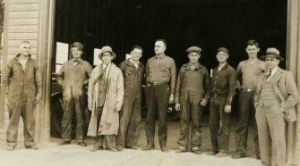 Big Potatoes: Jake, far right, dressed in a suit, in front of his auto dealership in 1928.