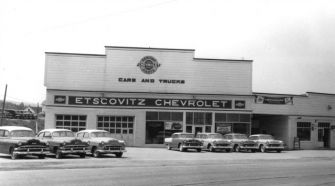Car Hawker: The scene outside Jake's car dealership in Fort Kent, sometime in the 1950s.