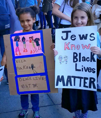 Johanna Cohen's daughter (right) pictured at the March for Racial Justice NYC