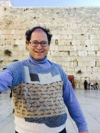 Barsky at the Western Wall, wearing his handmade sweater to match.
