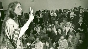 Involving the Community: Rabbi Lynn Gottlieb tells a Hanukkah story at her congregation Nahalat Shalom, circa 1998.
