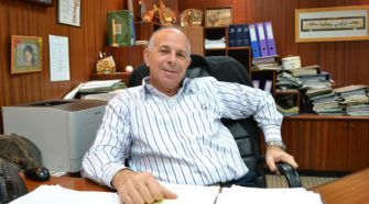 Miki Ziv, general manager of the station, in his office.