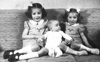 Only One Survived: Alfred Munzer at 6 months with sisters Eva (left) and Leah in May, 1942, in a photograph taken for his mother's birthday.