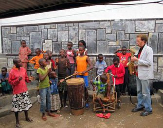 Making Music: Jeremy Danneman rehearsing with the Rwa Makondera Children?s Dance and Drumming group at the Ivuka Art Center in Kigali, Rwanda.