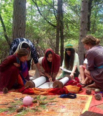 Students and teachers of the Kohenet Institute recite the Torah outdoors.