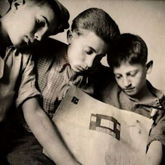 Buchenwald Boys: Abraham Tuszynsk shows his drawing to two friends who also survived deportation.