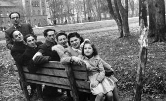 A group of Jewish Actors from displaced persons Camps sits on a park bench in Munich. Rogow is third from the left.