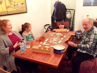 The Family In Action: The author's family enjoys a game of Rummikub.