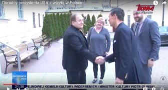 Trump Cred: Father Tadeusz Rydzyk (left) greets Trump adviser and Christian right activist Ralph Reed as Jonny Daniels (far right), who brokered the meeting, looks on, from coverage of the event on Radio Maryja's TV station.