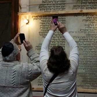 All the Shul's Men: Visitors taking photos of the Men's Wall, which dates from 1923.