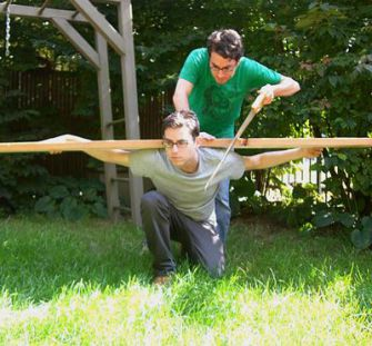 Sawhorse: Jonathan Safran Foer demonstrates the carpentry skills that were used, while brother Joshua bears the load.