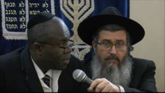 Shared Interests?: Ayi, left, with Rabbi Daniel Asor, interviewed in Israel.