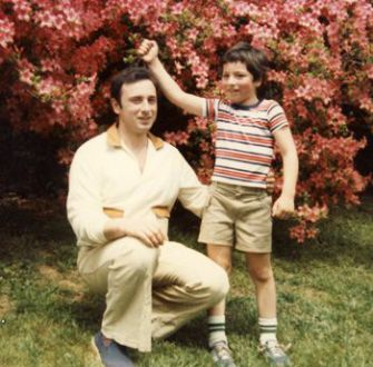 Welcome to America: Sergey Brin, 6, poses with his father, Michael, in Washington during the spring of 1980.