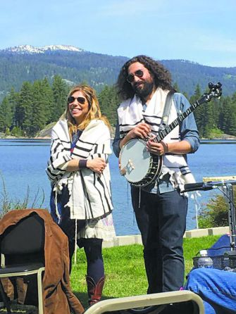 Morning Minyan: Doni Zasloff and Eric Lindberg, known together as Nefesh Mountain, lead a Sabbath sunrise service for Ahavath Beth Israel congregants during a retreat last summer in Ponderosa State Park.