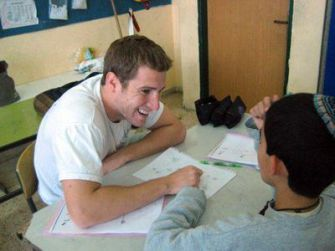 School Session: OTZMA participant Adam Resnik, left, has been teaching this summer at a school in Kiryat Malachi. Under the new teacher corps, participants will spend 10 months at one school.
