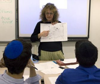Language Club: Teacher Orit Nawrocki leads a session at an after-school club that focuses on learning Arabic. The club is at Ramaz, a modern Orthodox school in Manhattan.