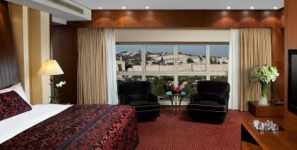 King David Hotel Plumped up pillows, an incomparable view of Jerusalem and a chess set that may be unused by Donald Trump.