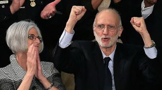 Alan Gross acknowledges cheers from Congress during State of the Union address.