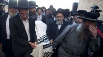 Ultra-Orthodox mourners carry the body of Moshe Twersky after he was slain in the Jerusalem synagogue terror attack.