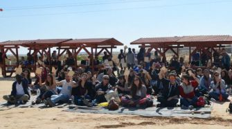Israeli activists join some of the nearly 2,000 immigrants held at Holot.