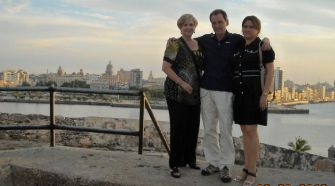 Saul Permutter poses with relatives along Havana's gorgeous — but crumbling —waterfront.