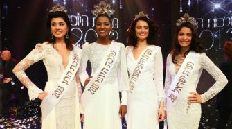 Trailblazer: Titi Aynaw at the Miss Israel pageant with other finalists. She is the first black woman to win the competition.