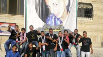 Revenge Victim: Members of the Abu Khdeir family sport shirts in support of Gaza, in front of a poster of Muhammad Abu Khdeir, who was slain by Jewish extremists.