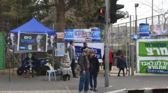 Posters for liberal parties dot the entrance to a voting place in Beit Hakerem, an artsy enclave in Jerusalem.