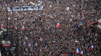 Marching Together: Demonstrators make their way along Boulevard Voltaire in a unity rally in Paris.