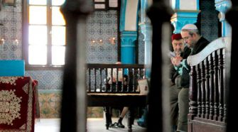 Men pray at the El Ghriba synagogue on Djerba.