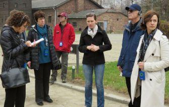 Sober Visit: Listening to the guide (center) at Auschwitz were, from left, Jane Eisner, Hilda Chazanovitz, Henry Pinskier, Robert Kraft and Winne Sandler.