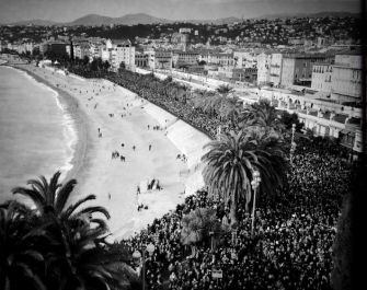 A black-and-white image shows thousands rallying in the French Riviera city of Nice to mourn the victims of this week's terrorist attacks in Paris.