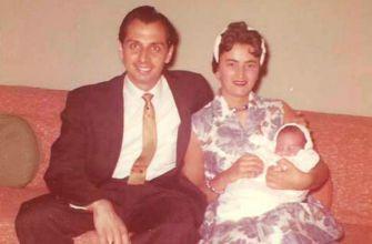 Godparents: Sylvia Sodden sits with Joseph Arrigo on her knee following Joseph's baptism in 1960. The gentleman is Arrigo's uncle and godfather, Joe Rosati.