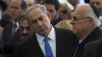 Israeli Prime Minister Benjamin Netanyahu and President Reuven Rivlin at funeral for kosher grocery victims.