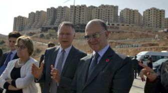 Development Town: French Finance Minister Pierre Moscovici, right, stands with Masri in 2013.