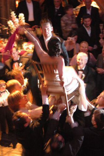 Up Above: Sara Schwimmer Marcus and David Marcus are lifted high on chairs at their wedding at The Angel Orensanz Foundation on August 6, 2006.